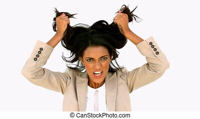 Stressed businesswoman shaking her hair in slow motion