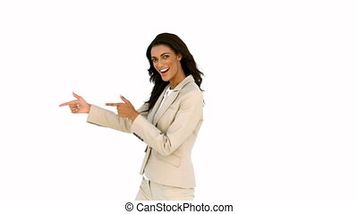 Businesswoman pointing her fingers and turning in slow...