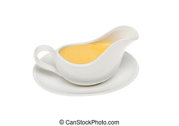 Yellow sauce in a sauce boat, could be custard or...