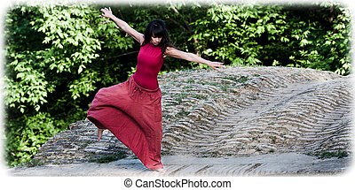 Contempory dancer spins on a bridge - Young female dancer...