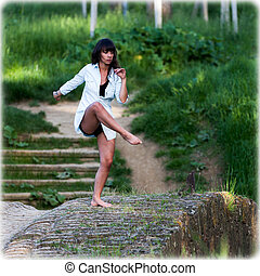 Contempory dancer outdoors - A woman keeping her balance on...