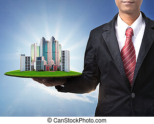 business man and real estate in hand use for property land...