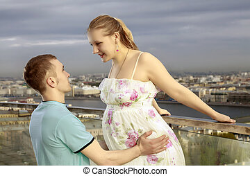 A young couple expecting a baby. Happy couple walking on the...