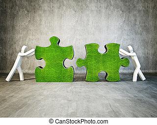 puzzle - two man building puzzle on concrete background