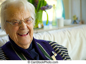 Elderly woman looking at the camera and smiling - Happy...