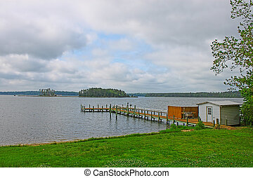 An HDR of a fishing pier/boat dock with a shed and cleaning...