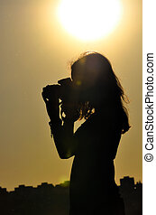 silhouette of girl in shooting time - silhouette of girl...