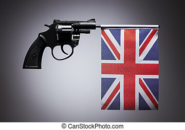 Gun crime concept of hand pistol showing the flag of united...