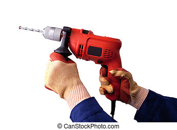 Gloved hands with electric drill - Gloved hands with an...