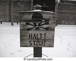 Halt! Stop! - Tablet STOP! infront of barbed wire under...
