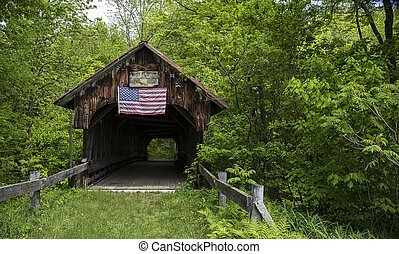 Covered bridge with American flag