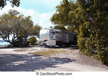 Fifth wheel camping trailer - Camping trailer at a camp site...