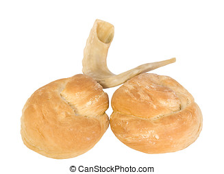 Rosh Hashanah shofar and round challah - Jewish New Year...