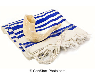 Rosh Hashanah holiday shofar and tallit - Traditional curved...