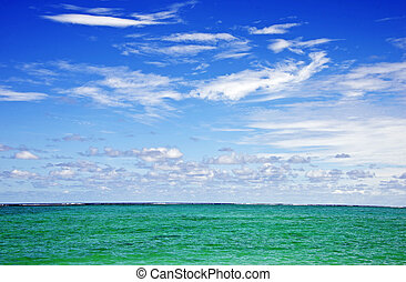 Wispy Clouds over Turquise Indian Ocean - Blue Sky with...