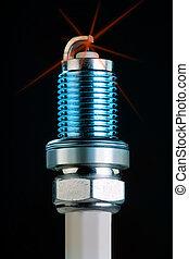 Spark Plug. - Spark plug with spark.