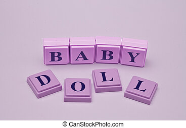 Baby Doll spelled out in wooden blocks