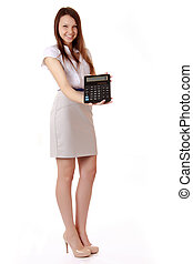 Female student with a calculator in hand. Laughing schoolgirl sh