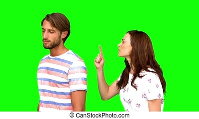 Couple arguing on green screen in slow motion