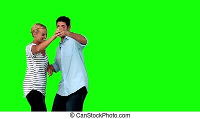 Lovers dancing together on green screen in slow motion