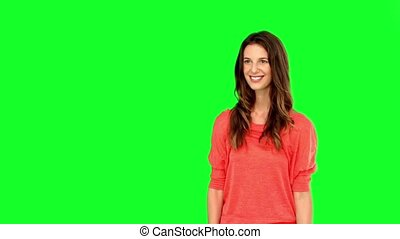 Woman catching a basketball on green screen in slow motion