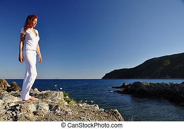 Woman gazing at evening sun
