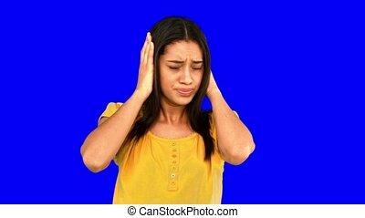 Upset woman shaking head in denial on blue screen in slow...
