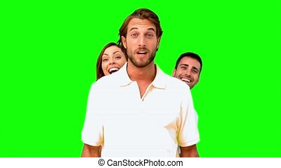Friends hiding behind a man - : Friends hiding behind a man...
