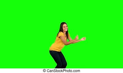 Woman jumping on green screen