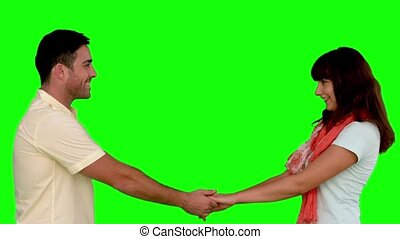 Young couple cuddling on green screen in slow motion on...