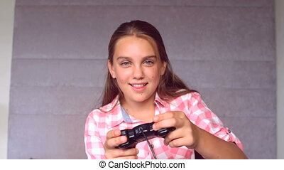 Girl playing at video game in slow motion at 250 frames per...