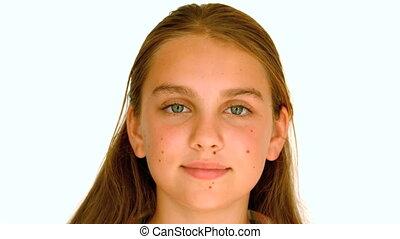 Girl smiling against white backgroud - Girl smiling against...