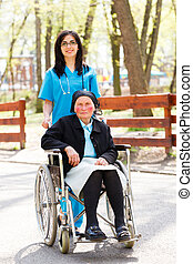 Residential Care - Beautiful doctor, nurse in blue coat...