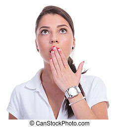casual woman looks up surprised - casual young woman looking...