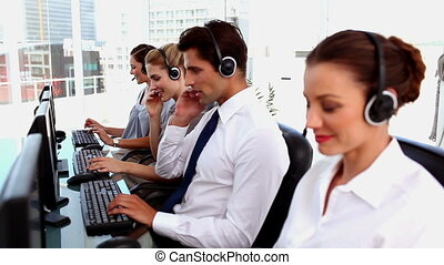 Smiling call centre agents with hea