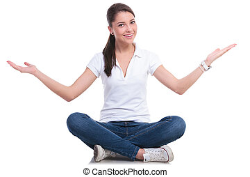 casual woman welcoming seated - casual young woman sitting...