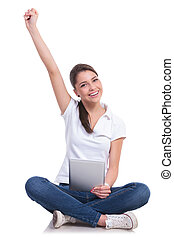 casual woman sits, cheers and tablet - casual young woman...
