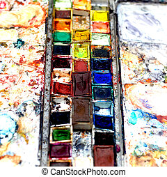 Heavily used Watercolor box with side palettes in a close up...