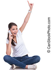 casual woman sits and points and talks - casual young woman...