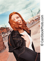 Woman portrait, windy city - Young woman smiling