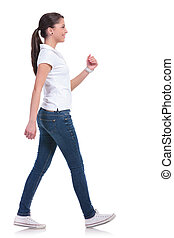 casual woman walking - side view of a casual young woman...