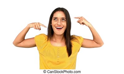 Woman making crazy gesture on white background in slow...