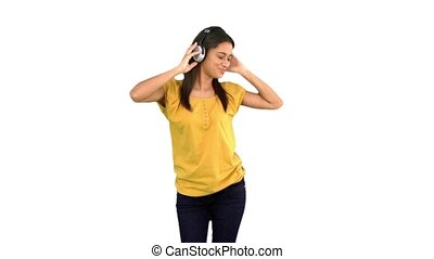 Woman dancing with headphones on wh