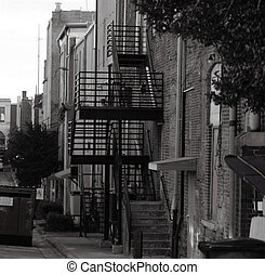 back alley - An urban back alley in shown in black and white