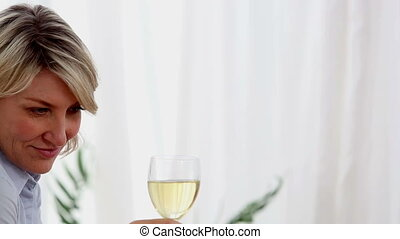 Woman holding a glass of white wine - Woman holding a glass...