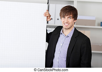 Businessman With Hand On Flip Chart