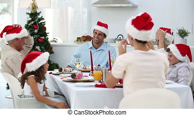 Family having christmas dinner at home in kitchen