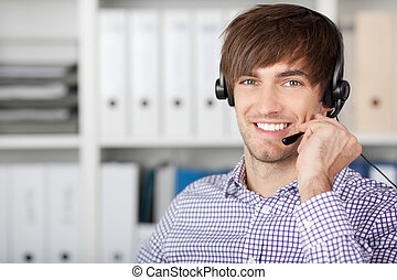 Customer Service Executive Using Headset In Office -...