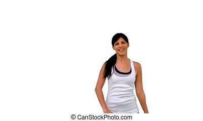 Fit woman stretching her arms and waving on white background...