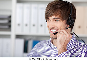 Smiling Customer Service Executive Using Headset